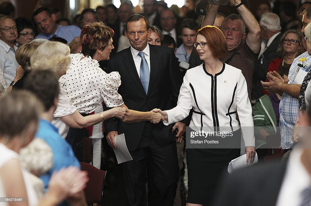 Prime Minister <a gi-track='captionPersonalityLinkClicked' href=/galleries/search?phrase=Julia+Gillard&family=editorial&specificpeople=787281 ng-click='$event.stopPropagation()'>Julia Gillard</a> and opposition leader Tony Abbot arrive to deliver their National Apology on Forced Adoption in the Great Hall at Parliament House, Canberra. More than 800 people were affected by the practice of forced adoption from the 1950s to 1970s.