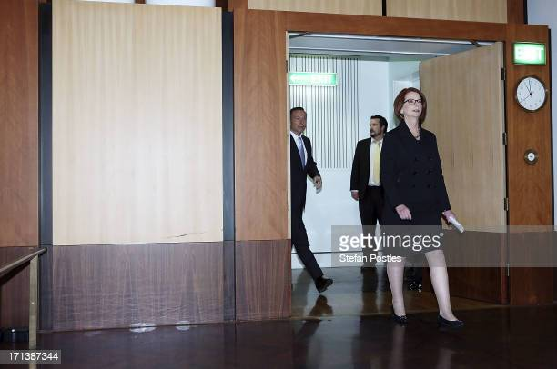 Prime Minister Julia Gillard and Opposition leader Tony Abbott arrive at the APH 25th Anniversary Morning Tea on June 24 2013 in Canberra Australia...