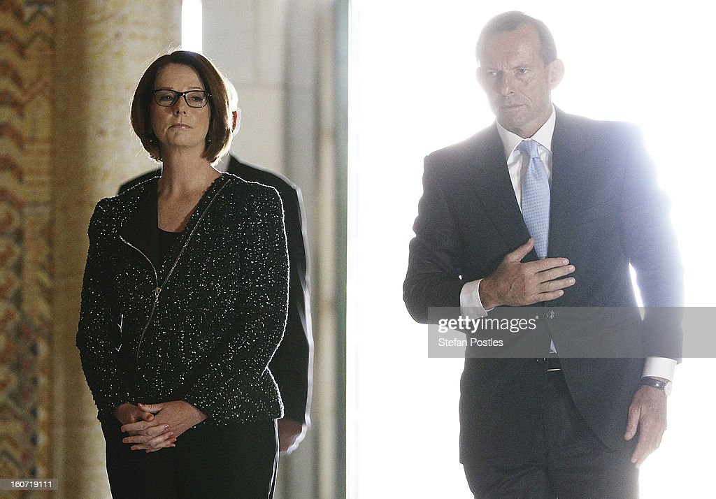 Prime Minister <a gi-track='captionPersonalityLinkClicked' href=/galleries/search?phrase=Julia+Gillard&family=editorial&specificpeople=787281 ng-click='$event.stopPropagation()'>Julia Gillard</a> and Opposition leader <a gi-track='captionPersonalityLinkClicked' href=/galleries/search?phrase=Tony+Abbott&family=editorial&specificpeople=220956 ng-click='$event.stopPropagation()'>Tony Abbott</a> lay a wreath in honor of fallen Australian soldiers at the Australian War Memorial on February 5, 2013 in Canberra, Australia. Parliament resumes for the first sitting of 2013 today, just days after Prime Minister Gillard, announced a federal election date of September 14, 2013.