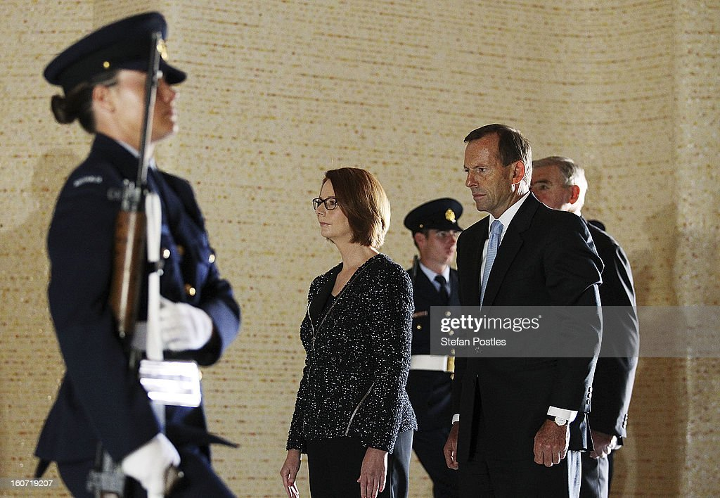 Prime Minister Julia Gillard and Opposition leader Tony Abbott lay a wreath in honor of fallen Australian soldiers at the Australian War Memorial on February 5, 2013 in Canberra, Australia. Parliament resumes for the first sitting of 2013 today, just days after Prime Minister Gillard, announced a federal election date of September 14, 2013.