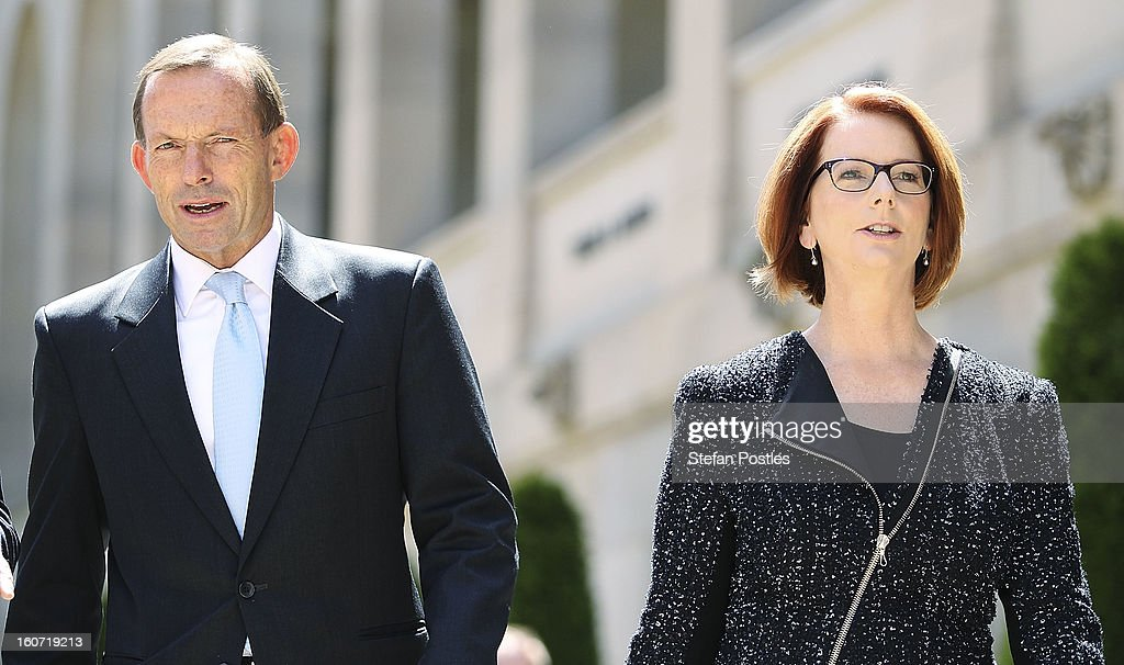 Prime Minister Julia Gillard and Opposition leader Tony Abbott leave together after laying a wreath in honor of fallen Australian soldiers at the Australian War Memorial on February 5, 2013 in Canberra, Australia. Parliament resumes for the first sitting of 2013 today, just days after Prime Minister Gillard, announced a federal election date of September 14, 2013.