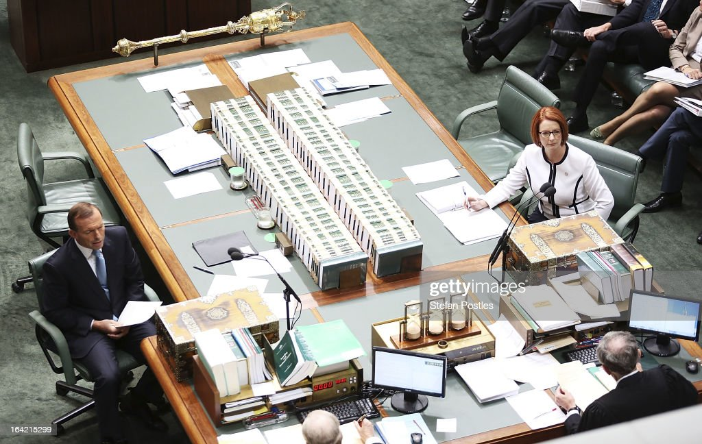 Prime Minister <a gi-track='captionPersonalityLinkClicked' href=/galleries/search?phrase=Julia+Gillard&family=editorial&specificpeople=787281 ng-click='$event.stopPropagation()'>Julia Gillard</a> and Opposition leader <a gi-track='captionPersonalityLinkClicked' href=/galleries/search?phrase=Tony+Abbott&family=editorial&specificpeople=220956 ng-click='$event.stopPropagation()'>Tony Abbott</a> sit opposite each other during House of Representatives question time on March 21, 2013 in Canberra, Australia. Australian Prime Minister <a gi-track='captionPersonalityLinkClicked' href=/galleries/search?phrase=Julia+Gillard&family=editorial&specificpeople=787281 ng-click='$event.stopPropagation()'>Julia Gillard</a> has called for a ballot today to decide the leader, and deputy leader of the Australian Labor Party, effectively a caucus vote that will decide the Prime Minister and Deputy Prime Minister of the country. Kevin Rudd is expected to nominate for the leadership and Simon Crean for the deputy position. Rudd, who was elected Prime Minister in the 2007 election was ousted by Gillard in June 2010, who then went on to win the 2010 Federal Election in August.