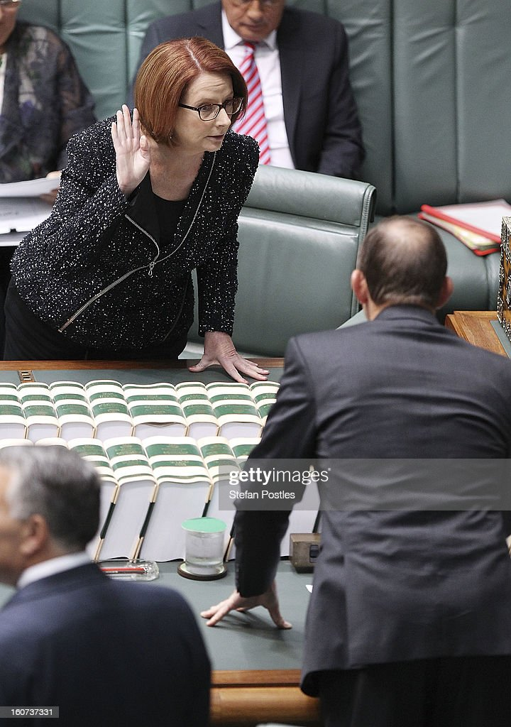 Prime Minister <a gi-track='captionPersonalityLinkClicked' href=/galleries/search?phrase=Julia+Gillard&family=editorial&specificpeople=787281 ng-click='$event.stopPropagation()'>Julia Gillard</a> and Opposition leader <a gi-track='captionPersonalityLinkClicked' href=/galleries/search?phrase=Tony+Abbott&family=editorial&specificpeople=220956 ng-click='$event.stopPropagation()'>Tony Abbott</a> speak prior to House of Representatives question time at Parliament House on February 5, 2013 in Canberra, Australia. Parliament resumes for the first sitting of 2013 today, just days after Prime Minister Gillard, announced a federal election date of September 14, 2013.