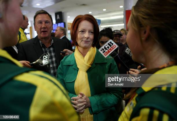 Prime Minister Julia Gillard greets members of the Australian Commonwealth Games team as it arrives at the Sydney International Airport on October 16...