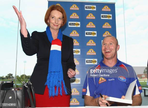 Prime Minister Julia Gillard is seen with Barry Hall at the official launch of his new book 'Pulling No Punches' at Whitten Oval on August 26 2011 in...