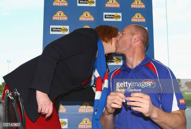 Prime Minister Julia Gillard kisses Barry Hall at the official launch of his new book 'Pulling No Punches' at Whitten Oval on August 26 2011 in...
