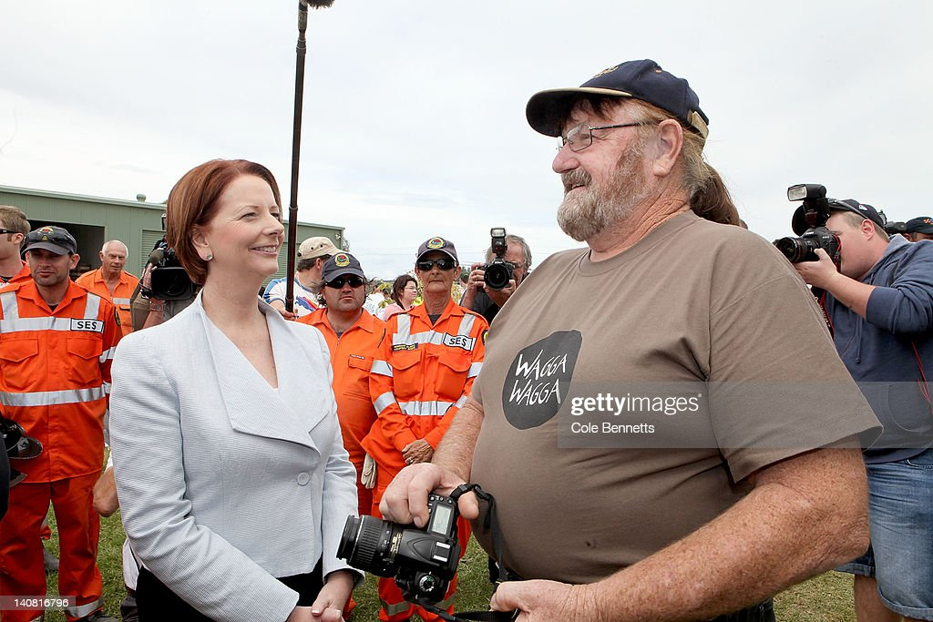 Prime Minister Julia Gillard meets a local astronomer during a tour of the SES head quarters on March 7, 2012 in Wagga Wagga, Australia. 9000 evacuated residents are waiting for authorities to survey the city's levee to determine if it is safe to return home, after flood waters peaked at 10.6 metres - less than the 10.9 metre peak predicted. Residents on Monday were instructed to evacuate and the town was declared a disaster zone with authorities predicting floodwaters to reach a level that would likely break the levee, flood the cities central district, and cause the worst flooding in decades.
