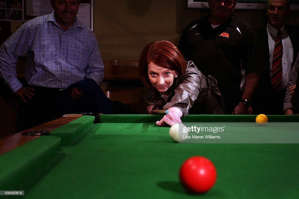 Prime Minister <a gi-track='captionPersonalityLinkClicked' href=/galleries/search?phrase=Julia+Gillard&family=editorial&specificpeople=787281 ng-click='$event.stopPropagation()'>Julia Gillard</a> plays pool with patrons at the Raymond Lakeside Tavern during the final week of campaigning ahead of this weekend's Federal Election at on August 19, 2010 in Raymond, Australia. Australian voters will head to the polls on August 21 to elect their 43rd Parliament.