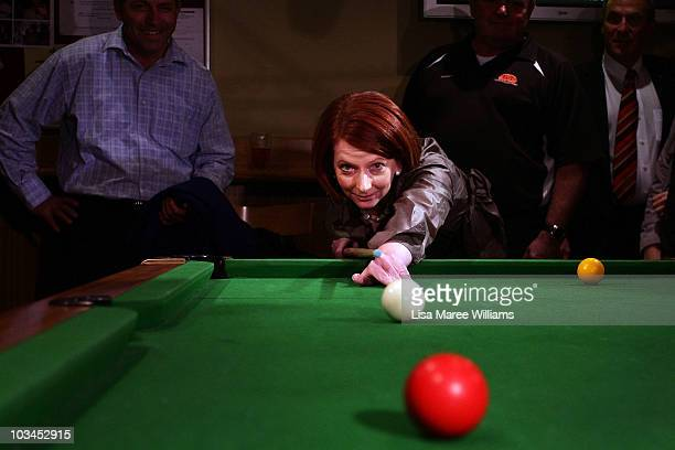 Prime Minister Julia Gillard plays pool with patrons at the Raymond Lakeside Tavern during the final week of campaigning ahead of this weekend's...