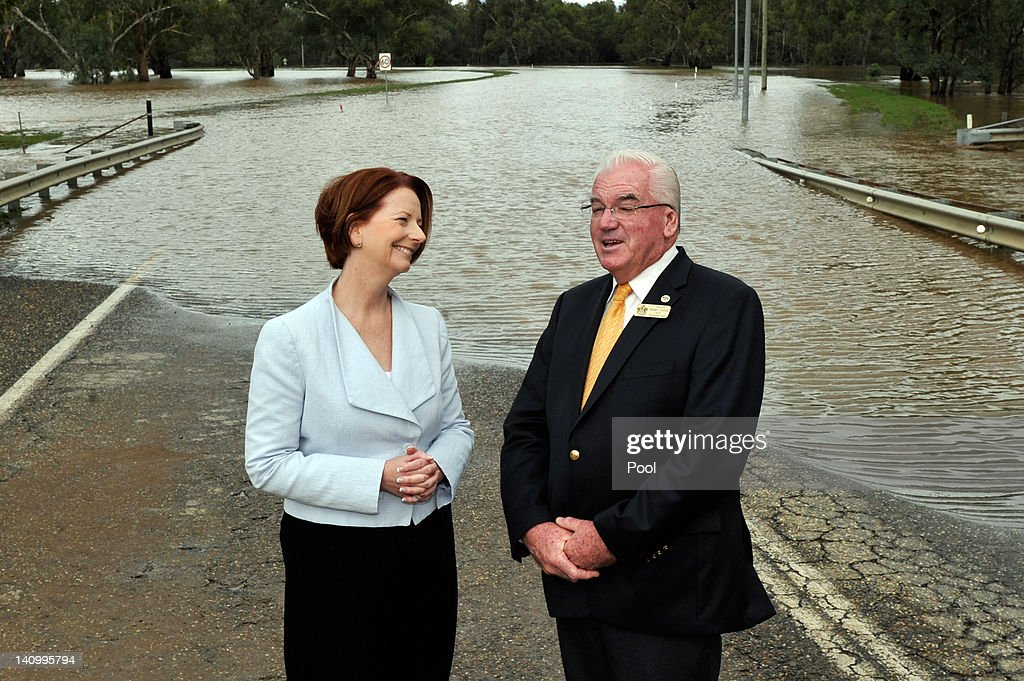 Prime Minister <a gi-track='captionPersonalityLinkClicked' href=/galleries/search?phrase=Julia+Gillard&family=editorial&specificpeople=787281 ng-click='$event.stopPropagation()'>Julia Gillard</a> speaks with City of Wagga Wagga Mayor Kerry Pascoe on Wiradjuri Bridge on March 7, 2012 in Wagga Wagga, Australia. 9000 evacuated residents are waiting for authorities to survey the city's levee to determine if it is safe to return home, after flood waters peaked at 10.6 metres - less than the 10.9 metre peak predicted. Residents on Monday were instructed to evacuate and the town was declared a disaster zone with authorities predicting floodwaters to reach a level that would likely break the levee, flood the cities central district, and cause the worst flooding in decades.