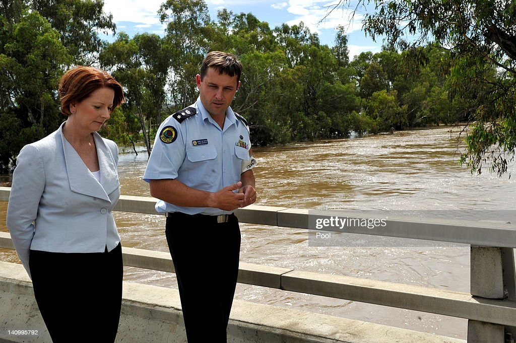 Prime Minister <a gi-track='captionPersonalityLinkClicked' href=/galleries/search?phrase=Julia+Gillard&family=editorial&specificpeople=787281 ng-click='$event.stopPropagation()'>Julia Gillard</a> speaks with SES Regional Controller James McTavish on Wiradjuri Bridge on March 7, 2012 in Wagga Wagga, Australia. 9000 evacuated residents are waiting for authorities to survey the city's levee to determine if it is safe to return home, after flood waters peaked at 10.6 metres - less than the 10.9 metre peak predicted. Residents on Monday were instructed to evacuate and the town was declared a disaster zone with authorities predicting floodwaters to reach a level that would likely break the levee, flood the cities central district, and cause the worst flooding in decades.