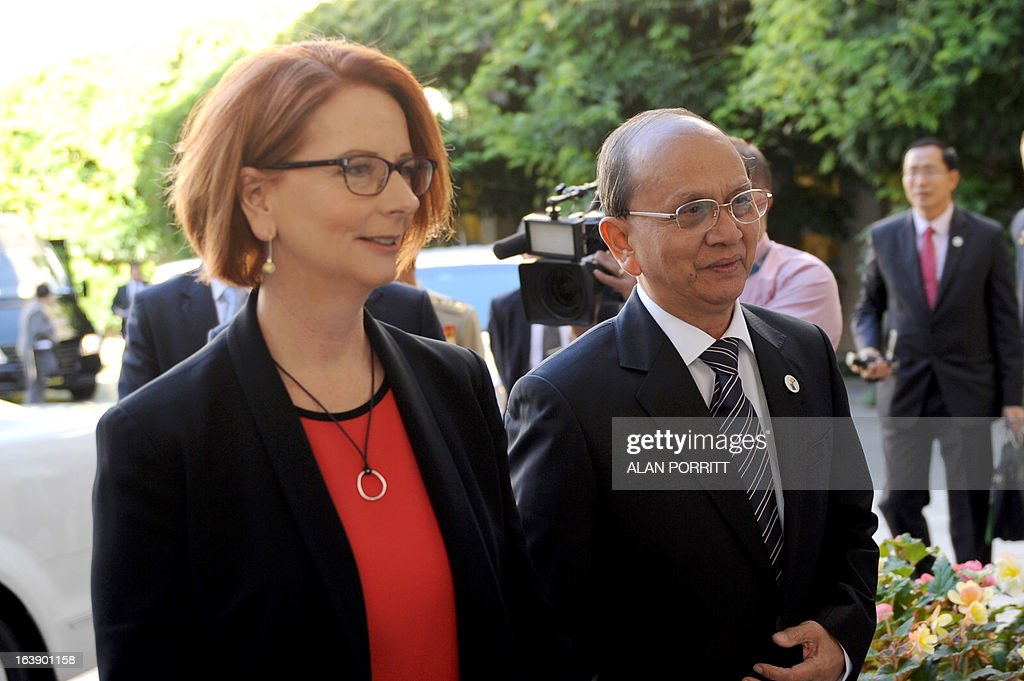 Prime Minister Julia Gillard (L) walks with the President of Myanmar Thein Sein at Parliament House in Canberra March 18, 2013. President Thein Sein is visiting Australia from 17 to 20 March and is the first by a head of state of Myanmar since 1974. AFP PHOTO / Alan Porritt / POOL