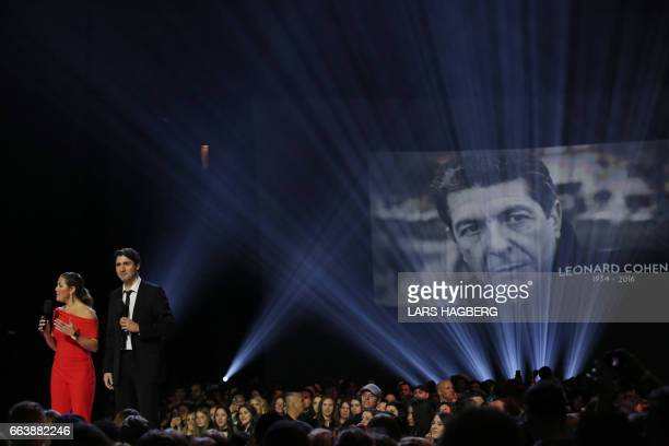 Prime Minister Justin Trudeau and his wife Sophie Gregoire Trudeau pay tribute to the late musician Lenoard Cohen during the JUNO awards show at the...
