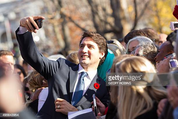 Prime Minister Justin Trudeau takes a selfie as he greets the crowd outside Rideau Hall after being sworn in as Canada's 23rd Prime Minister in...