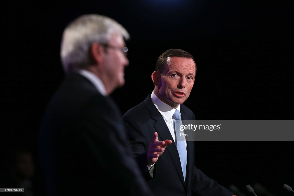Prime Minister <a gi-track='captionPersonalityLinkClicked' href=/galleries/search?phrase=Kevin+Rudd&family=editorial&specificpeople=707751 ng-click='$event.stopPropagation()'>Kevin Rudd</a> and Opposition Leader <a gi-track='captionPersonalityLinkClicked' href=/galleries/search?phrase=Tony+Abbott&family=editorial&specificpeople=220956 ng-click='$event.stopPropagation()'>Tony Abbott</a> during the Leaders Debate at the National Press Club on August 11, 2013 in Canberra, Australia. This is the first debate the Labor and Liberal parties have agreed on, with Rudd seeking as many debates as possible and Abbott arguing for three debates in total, including two town hall-style events. Australians will head to the polls on September 7.