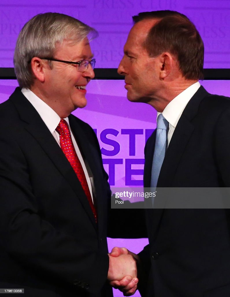 Prime Minister Kevin Rudd and Opposition Leader Tony Abbott shake hands at the commencement of the Leaders Debate at the National Press Club on...