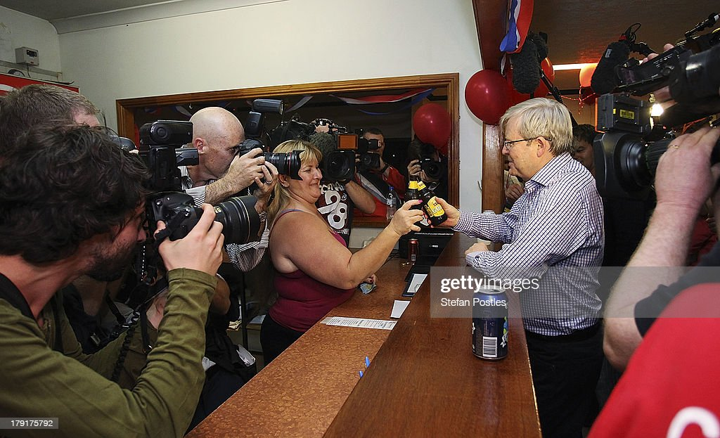 Prime Minister Kevin Rudd gets a beer during the Labor candidate Cathy O'Toole's campaign launch at the Wanderers Cricket Club on September 1 2013 in...