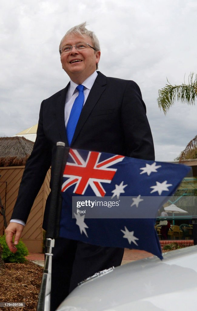 Prime Minister Kevin Rudd leaves after speaking to aged care workers at St Laurence's Hostel on September 4 2013 in Adelaide Australia With just...