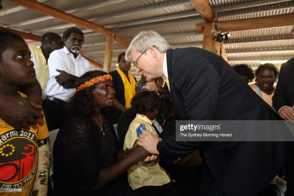 Prime Minister <a gi-track='captionPersonalityLinkClicked' href=/galleries/search?phrase=Kevin+Rudd&family=editorial&specificpeople=707751 ng-click='$event.stopPropagation()'>Kevin Rudd</a> offers condolences to the widow of Mr Yunupingu, Yalmay Yunupingu during the state memorial service for 'Yothu Yindi' founder Mr Yunupingu on June 30, 2013 in Gulkula, Nhulunbuy in the Northern Territory, Australia. Former Yothu Yindi singer and indigenous educator Yunupingu died almost a month ago aged 56.
