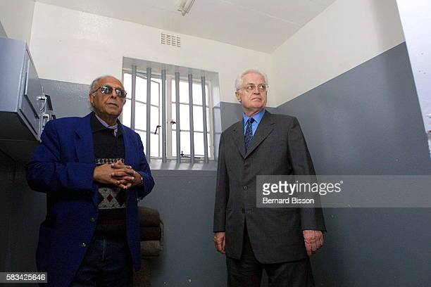Prime Minister Lionel Jospin in the presence of a former prisoner Ahmed Kathrada in the cell where Nelson Mandela was held prisoner