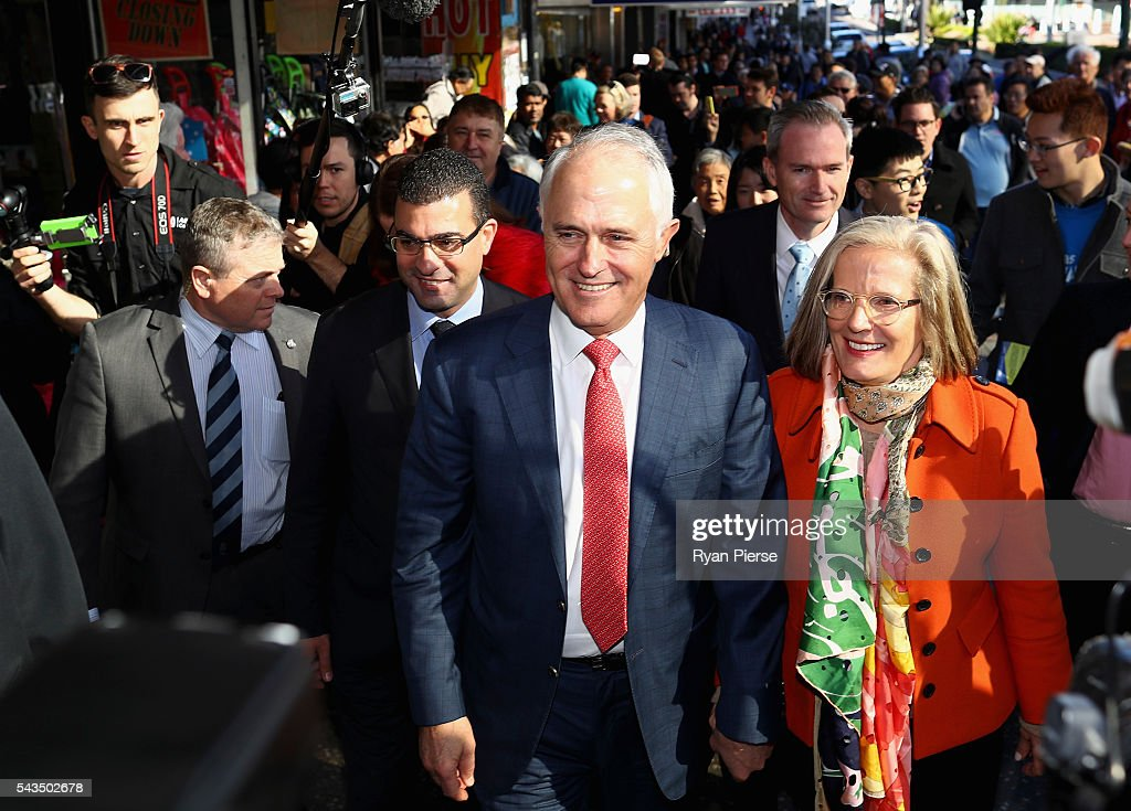 Prime Minister Malcolm Turnbull and his wife Lucy Turnbull arrive at Hurstville Station as he campaigns in Barton on June 29, 2016 in Sydney, Australia.