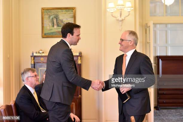 Prime Minister Malcolm Turnbull and Sentor Matt Canavan shake hands at Government House on October 27 2017 in Canberra Australia The ministers were...