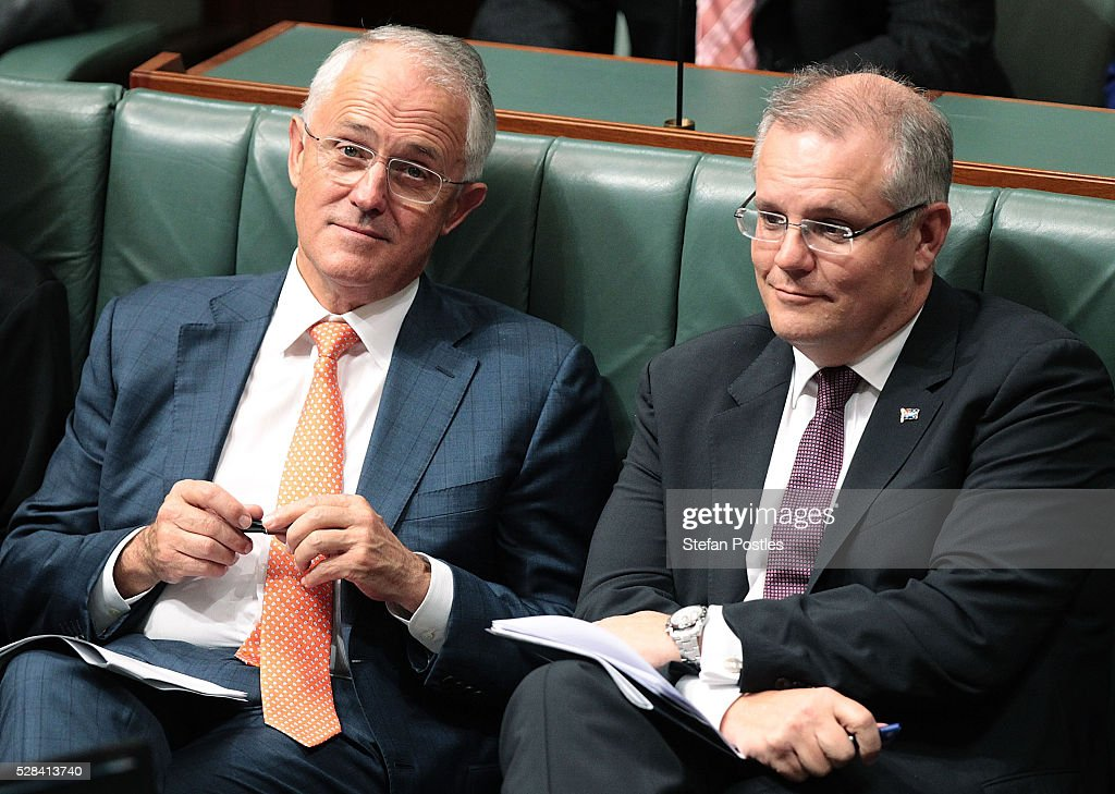 Prime Minister <a gi-track='captionPersonalityLinkClicked' href=/galleries/search?phrase=Malcolm+Turnbull&family=editorial&specificpeople=2125595 ng-click='$event.stopPropagation()'>Malcolm Turnbull</a> and Treasurer <a gi-track='captionPersonalityLinkClicked' href=/galleries/search?phrase=Scott+Morrison+-+Politician&family=editorial&specificpeople=15789813 ng-click='$event.stopPropagation()'>Scott Morrison</a> listen to Opposition leader Bill Shorten deliver his budget reply speech on May 5, 2016 in Canberra, Australia. The Turnbull Government's first budget has delivered tax cuts for small and medium businesses, income tax cuts people earning over $80,000 a year,new measures to help young Australians into jobs and cutbacks to superannuation concessions for the wealthy.