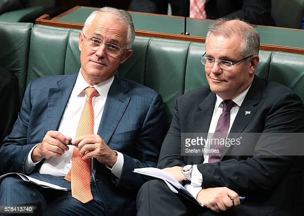 Prime Minister Malcolm Turnbull and Treasurer Scott Morrison listen to Opposition leader Bill Shorten deliver his budget reply speech on May 5 2016...