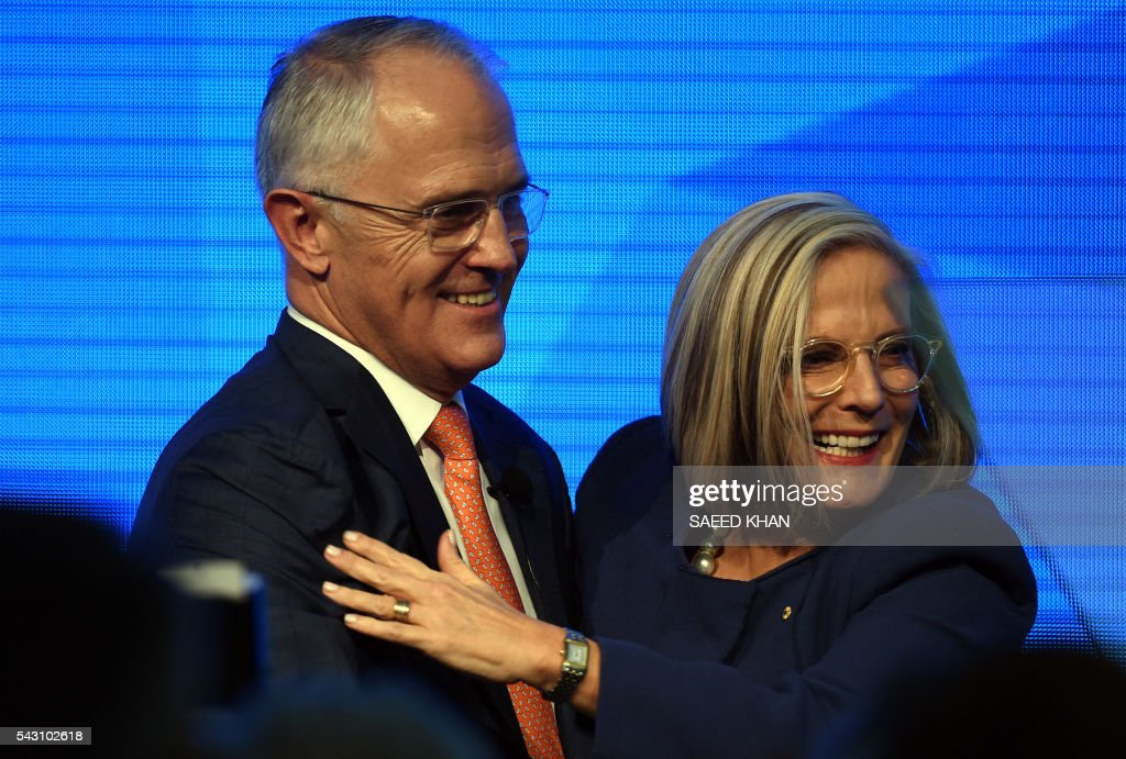Prime Minister Malcolm Turnbull hugs his wife Lucy following his address at the Coalition Campaign launch in Sydney on June 26, 2016. Turnbull used the chaos from Brexit to make a pitch for Australians to re-elect his coalition government, promising stability and strong economic leadership a week out from national polls to be held on July 2. / AFP / SAEED