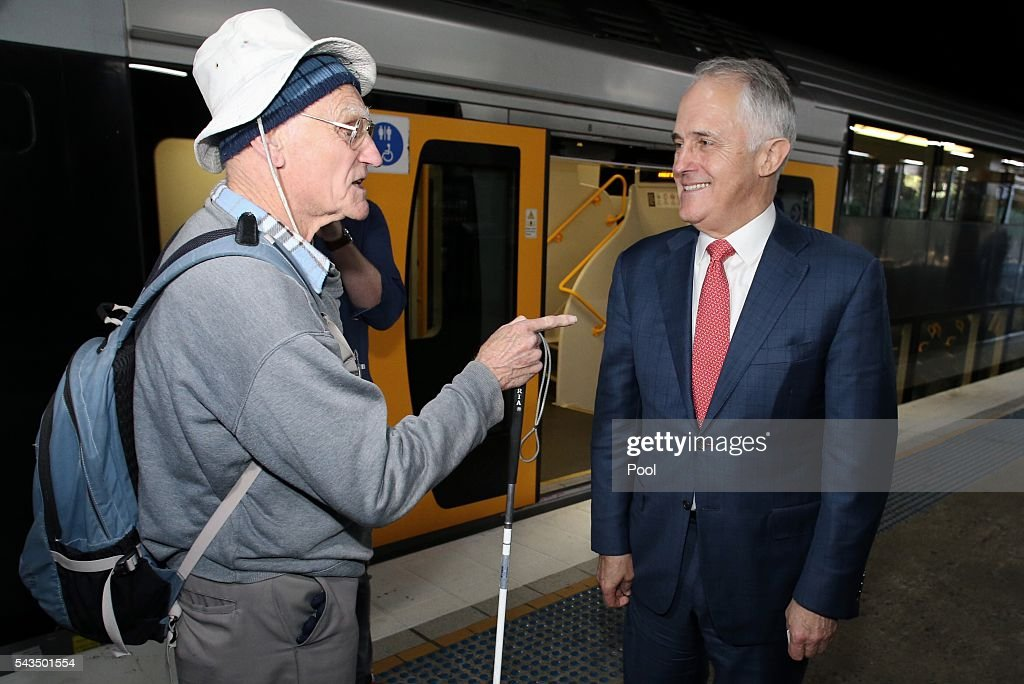 Prime Minister <a gi-track='captionPersonalityLinkClicked' href=/galleries/search?phrase=Malcolm+Turnbull&family=editorial&specificpeople=2125595 ng-click='$event.stopPropagation()'>Malcolm Turnbull</a> is met by an unhappy voter when he and Lucy Turnbull arrives at Hurstville Station as he campaigns in the electorate of Barton on June 29, 2016 in Sydney, Australia. The Liberal Party given $40,000 in campaign funds to charity after the party inappropriately used Lucy Turnbull's position as the head of a NSW Government planning body to promote two fundraisers in Sydney. Mrs Turnbull believed she had been invited as the Prime Minister's wife.