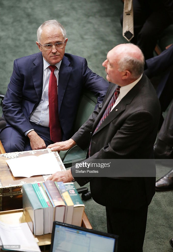 Prime Minister Malcolm Turnbull listens to Deputy Prime Minister Warren Truss announce his retirement in the House of Representatives on February 11, 2016 in Canberra, Australia. Nationals Leader and Deputy Prime Minister Warren Truss and Trade Minister Andrew Robb will retire at the next election.
