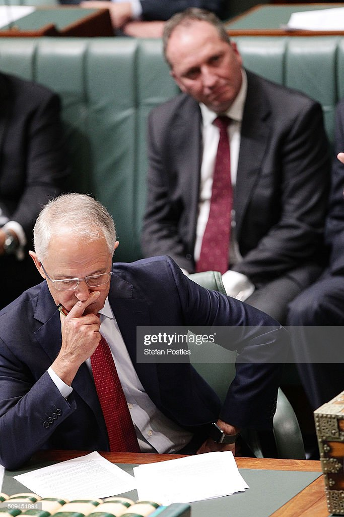 Prime Minister <a gi-track='captionPersonalityLinkClicked' href=/galleries/search?phrase=Malcolm+Turnbull&family=editorial&specificpeople=2125595 ng-click='$event.stopPropagation()'>Malcolm Turnbull</a> listens to Deputy Prime Minister Warren Truss announce his retirement in the House of Representatives on February 11, 2016 in Canberra, Australia. Nationals Leader and Deputy Prime Minister Warren Truss and Trade Minister Andrew Robb will retire at the next election.