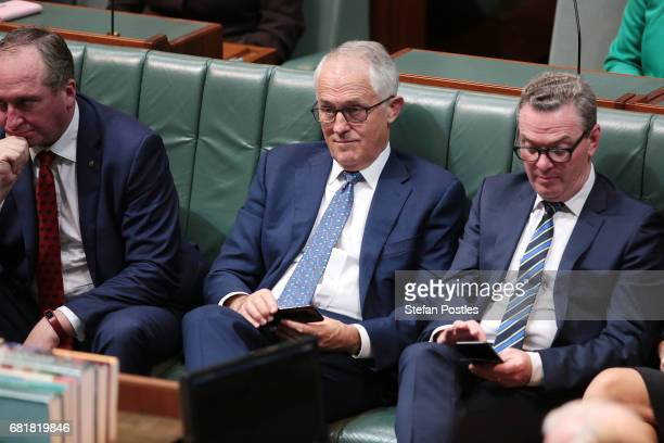Prime Minister Malcolm Turnbull listens to Opposition Leader Bill Shorten deliver his budget reply address in the House of Representatives at...