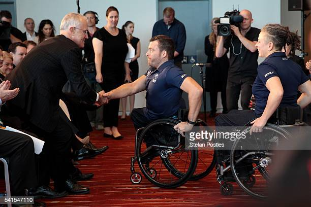 Prime Minister Malcolm Turnbull shakes hands with Australian Paralympian Kurt Fearnley during a launch at ANZ stadium on June 20 2016 in Sydney...