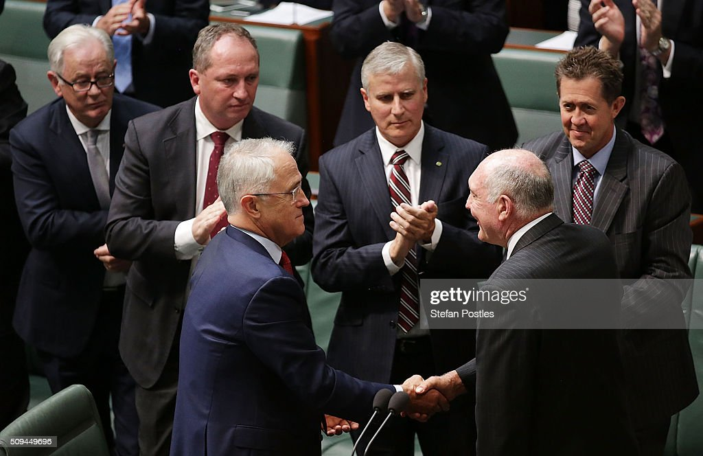 Prime Minister Malcolm Turnbull shakes hands with Deputy Prime Minister Warren Truss after he announced his retirement in the House of Representatives on February 11, 2016 in Canberra, Australia. Nationals Leader and Deputy Prime Minister Warren Truss and Trade Minister Andrew Robb will retire at the next election.