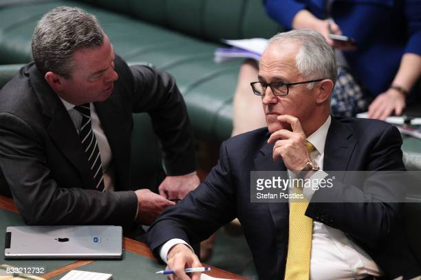 Prime Minister Malcolm Turnbull speaks with Minister for Defence Industry Christopher Pyne during House of Representatives question time at...