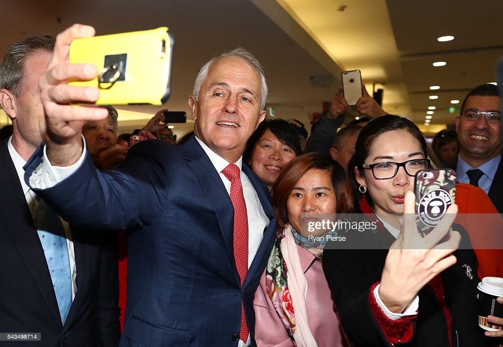 Prime Minister <a gi-track='captionPersonalityLinkClicked' href=/galleries/search?phrase=Malcolm+Turnbull&family=editorial&specificpeople=2125595 ng-click='$event.stopPropagation()'>Malcolm Turnbull</a> takes a selfie at Hurstville Station as he campaigns in the electorate of Barton on June 29, 2016 in Sydney, Australia. The Liberal Party given $40,000 in campaign funds to charity after the party inappropriately used Lucy Turnbull's position as the head of a NSW Government planning body to promote two fundraisers in Sydney. Mrs Turnbull believed she had been invited as the Prime Minister's wife.