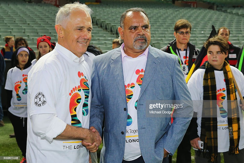 Prime Minister Malcom Turnbull and former Bombers legend <a gi-track='captionPersonalityLinkClicked' href=/galleries/search?phrase=Michael+Long+-+Australian+Rules+Footballer&family=editorial&specificpeople=178977 ng-click='$event.stopPropagation()'>Michael Long</a> (R) shake hands during The Long Walk before the round 10 AFL match between the Essendon Bombers and the Richmond Tigers at Melbourne Cricket Ground on May 28, 2016 in Melbourne, Australia. The Long Walk raises awareness for Indigenous Rights affairs.