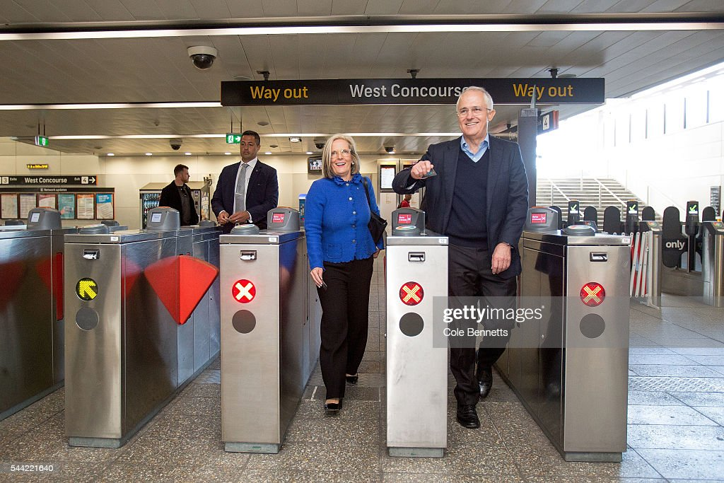 Prime Minister Malcom Turnbull and his wife Lucy go through the turnstiles at the Parramatta train station ready to catch a train after meeting and greeting voters at the Town Hall on July 2, 2016 in Parramatta, Australia. Voters head to the polls today to elect the 45th parliament of Australia.