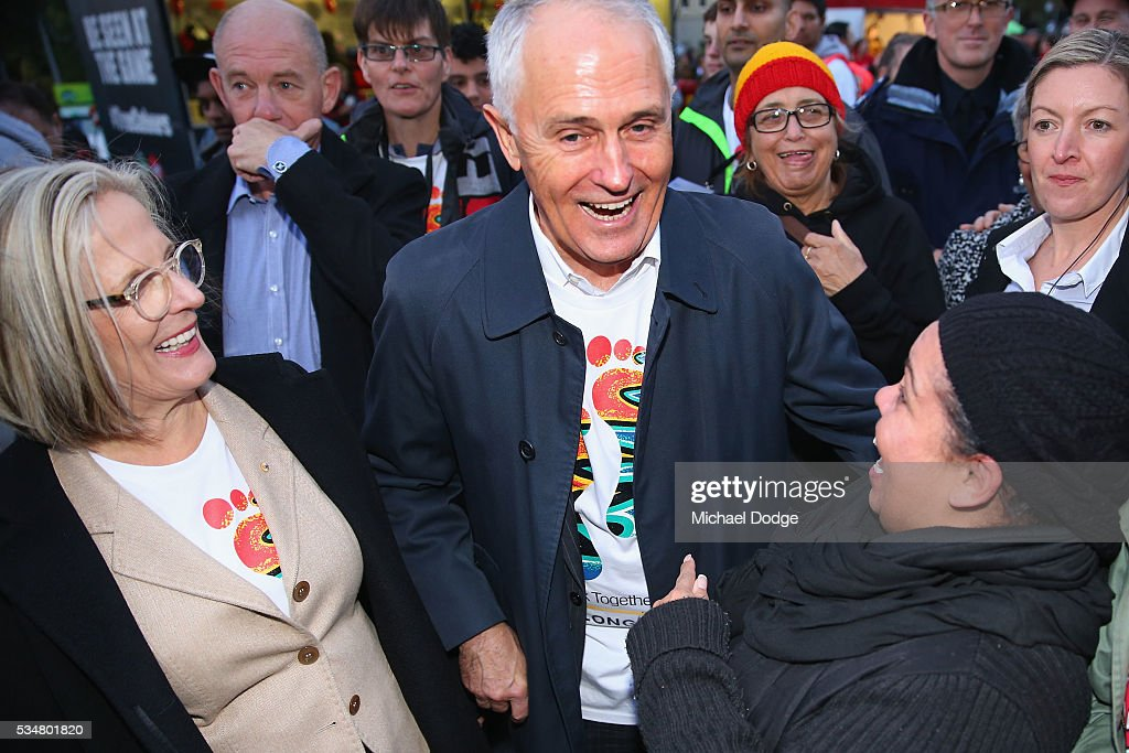 Prime Minister Malcom Turnbull and his wife <a gi-track='captionPersonalityLinkClicked' href=/galleries/search?phrase=Lucy+Turnbull&family=editorial&specificpeople=240445 ng-click='$event.stopPropagation()'>Lucy Turnbull</a> are greeted by Bombers fans during The Long Walk before the round 10 AFL match between the Essendon Bombers and the Richmond Tigers at Melbourne Cricket Ground on May 28, 2016 in Melbourne, Australia. The Long Walk raises awareness for Indigenous Rights affairs.