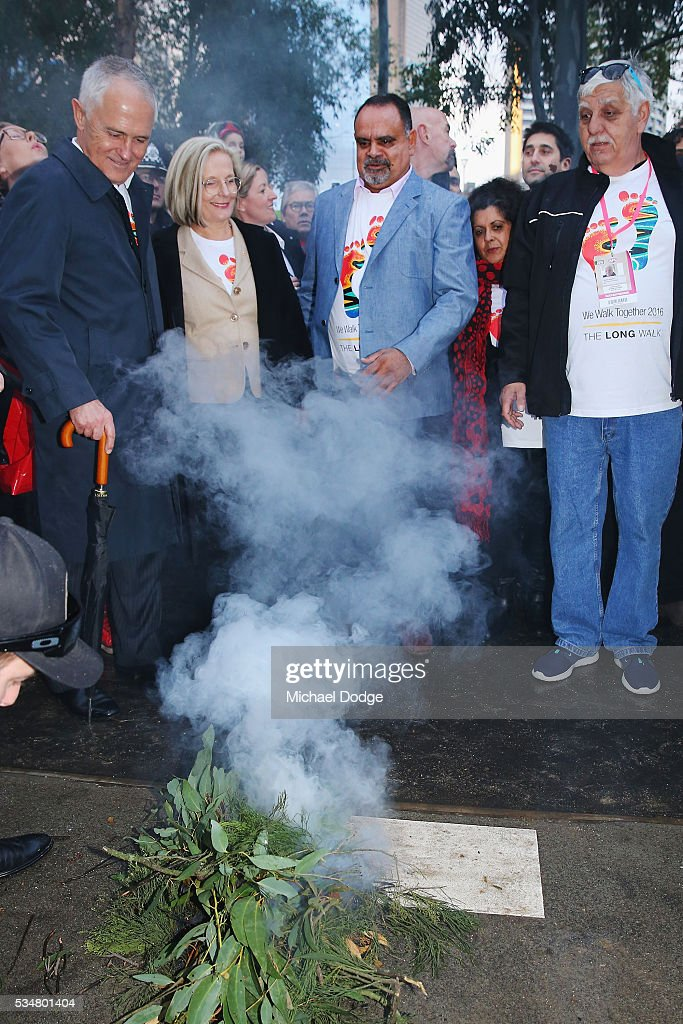 Prime Minister Malcom Turnbull and his wife <a gi-track='captionPersonalityLinkClicked' href=/galleries/search?phrase=Lucy+Turnbull&family=editorial&specificpeople=240445 ng-click='$event.stopPropagation()'>Lucy Turnbull</a> join former Bombers legend <a gi-track='captionPersonalityLinkClicked' href=/galleries/search?phrase=Michael+Long+-+Jugador+de+f%C3%BAtbol+australiano&family=editorial&specificpeople=178977 ng-click='$event.stopPropagation()'>Michael Long</a> (C) for The Long Walk before the round 10 AFL match between the Essendon Bombers and the Richmond Tigers at Melbourne Cricket Ground on May 28, 2016 in Melbourne, Australia. The Long Walk raises awareness for Indigenous Rights affairs.