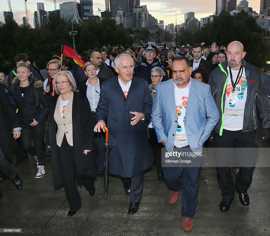 Prime Minister Malcom Turnbull and his wife <a gi-track='captionPersonalityLinkClicked' href=/galleries/search?phrase=Lucy+Turnbull&family=editorial&specificpeople=240445 ng-click='$event.stopPropagation()'>Lucy Turnbull</a> join former Bombers legend <a gi-track='captionPersonalityLinkClicked' href=/galleries/search?phrase=Michael+Long+-+Jugador+de+f%C3%BAtbol+australiano&family=editorial&specificpeople=178977 ng-click='$event.stopPropagation()'>Michael Long</a> (R) for The Long Walk before the round 10 AFL match between the Essendon Bombers and the Richmond Tigers at Melbourne Cricket Ground on May 28, 2016 in Melbourne, Australia. The Long Walk raises awareness for Indigenous Rights affairs.