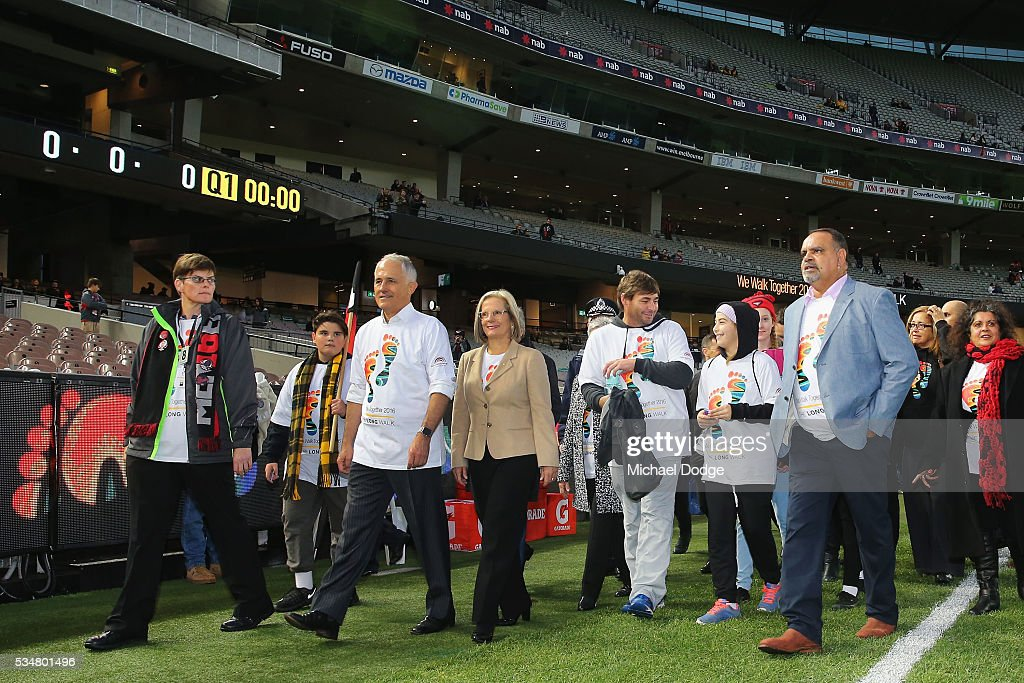 Prime Minister Malcom Turnbull and his wife <a gi-track='captionPersonalityLinkClicked' href=/galleries/search?phrase=Lucy+Turnbull&family=editorial&specificpeople=240445 ng-click='$event.stopPropagation()'>Lucy Turnbull</a> join former Bombers legend <a gi-track='captionPersonalityLinkClicked' href=/galleries/search?phrase=Michael+Long+-+Giocatore+di+football+australiano&family=editorial&specificpeople=178977 ng-click='$event.stopPropagation()'>Michael Long</a> (C) for The Long Walk before the round 10 AFL match between the Essendon Bombers and the Richmond Tigers at Melbourne Cricket Ground on May 28, 2016 in Melbourne, Australia. The Long Walk raises awareness for Indigenous Rights affairs.