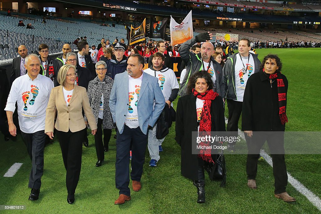 Prime Minister Malcom Turnbull and his wife <a gi-track='captionPersonalityLinkClicked' href=/galleries/search?phrase=Lucy+Turnbull&family=editorial&specificpeople=240445 ng-click='$event.stopPropagation()'>Lucy Turnbull</a> join former Bombers legend <a gi-track='captionPersonalityLinkClicked' href=/galleries/search?phrase=Michael+Long+-+Australian-Football-Spieler&family=editorial&specificpeople=178977 ng-click='$event.stopPropagation()'>Michael Long</a> (C) for The Long Walk before the round 10 AFL match between the Essendon Bombers and the Richmond Tigers at Melbourne Cricket Ground on May 28, 2016 in Melbourne, Australia. The Long Walk raises awareness for Indigenous Rights affairs.