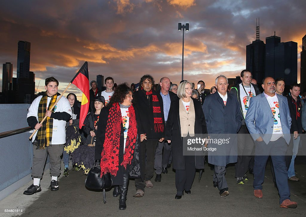 Prime Minister Malcom Turnbull and his wife <a gi-track='captionPersonalityLinkClicked' href=/galleries/search?phrase=Lucy+Turnbull&family=editorial&specificpeople=240445 ng-click='$event.stopPropagation()'>Lucy Turnbull</a> join former Bombers legend <a gi-track='captionPersonalityLinkClicked' href=/galleries/search?phrase=Michael+Long+-+Australian-Football-Spieler&family=editorial&specificpeople=178977 ng-click='$event.stopPropagation()'>Michael Long</a> (R) for The Long Walk before the round 10 AFL match between the Essendon Bombers and the Richmond Tigers at Melbourne Cricket Ground on May 28, 2016 in Melbourne, Australia. The Long Walk raises awareness for Indigenous Rights affairs.