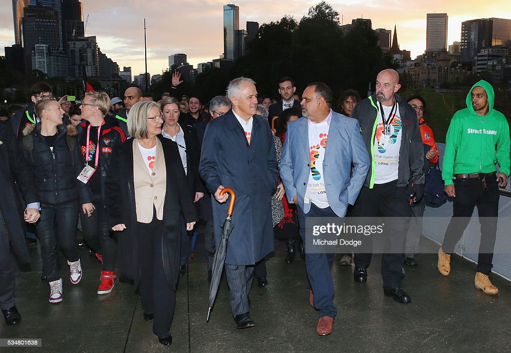 Prime Minister Malcom Turnbull and his wife <a gi-track='captionPersonalityLinkClicked' href=/galleries/search?phrase=Lucy+Turnbull&family=editorial&specificpeople=240445 ng-click='$event.stopPropagation()'>Lucy Turnbull</a> join former Bombers legend <a gi-track='captionPersonalityLinkClicked' href=/galleries/search?phrase=Michael+Long+-+Giocatore+di+football+australiano&family=editorial&specificpeople=178977 ng-click='$event.stopPropagation()'>Michael Long</a> (R) for The Long Walk before the round 10 AFL match between the Essendon Bombers and the Richmond Tigers at Melbourne Cricket Ground on May 28, 2016 in Melbourne, Australia. The Long Walk raises awareness for Indigenous Rights affairs.