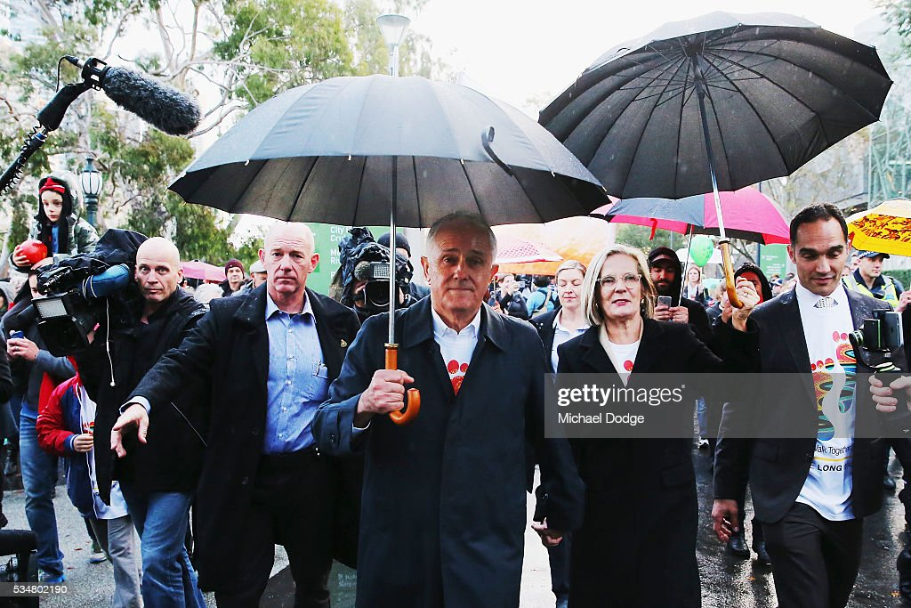 Prime Minister Malcom Turnbull and his wife <a gi-track='captionPersonalityLinkClicked' href=/galleries/search?phrase=Lucy+Turnbull&family=editorial&specificpeople=240445 ng-click='$event.stopPropagation()'>Lucy Turnbull</a> join The Long Walk before the round 10 AFL match between the Essendon Bombers and the Richmond Tigers at Melbourne Cricket Ground on May 28, 2016 in Melbourne, Australia. The Long Walk raises awareness for Indigenous Rights affairs.