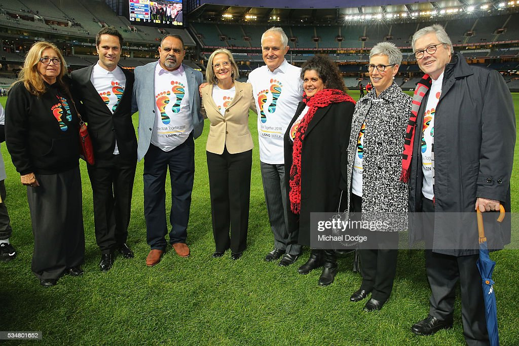 Prime Minister Malcom Turnbull and his wife <a gi-track='captionPersonalityLinkClicked' href=/galleries/search?phrase=Lucy+Turnbull&family=editorial&specificpeople=240445 ng-click='$event.stopPropagation()'>Lucy Turnbull</a> pose with former Bombers legend <a gi-track='captionPersonalityLinkClicked' href=/galleries/search?phrase=Michael+Long+-+Giocatore+di+football+australiano&family=editorial&specificpeople=178977 ng-click='$event.stopPropagation()'>Michael Long</a> (3rd L) for The Long Walk before the round 10 AFL match between the Essendon Bombers and the Richmond Tigers at Melbourne Cricket Ground on May 28, 2016 in Melbourne, Australia. The Long Walk raises awareness for Indigenous Rights affairs.