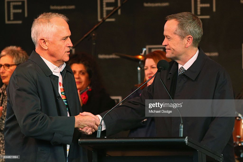Prime Minister Malcom Turnbull and Labor Leader Bill Shorton (R) shake hands before The Long Walk before the round 10 AFL match between the Essendon Bombers and the Richmond Tigers at Melbourne Cricket Ground on May 28, 2016 in Melbourne, Australia. The Long Walk raises awareness for Indigenous Rights affairs.