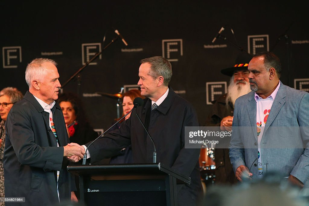 Prime Minister Malcom Turnbull and Labor Leader Bill Shorton (R) shake handsnext to former Bomber player <a gi-track='captionPersonalityLinkClicked' href=/galleries/search?phrase=Michael+Long+-+Jugador+de+f%C3%BAtbol+australiano&family=editorial&specificpeople=178977 ng-click='$event.stopPropagation()'>Michael Long</a> before The Long Walk before the round 10 AFL match between the Essendon Bombers and the Richmond Tigers at Melbourne Cricket Ground on May 28, 2016 in Melbourne, Australia. The Long Walk raises awareness for Indigenous Rights affairs.